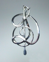 Sterling silver pin with G clef, baton and Initial D